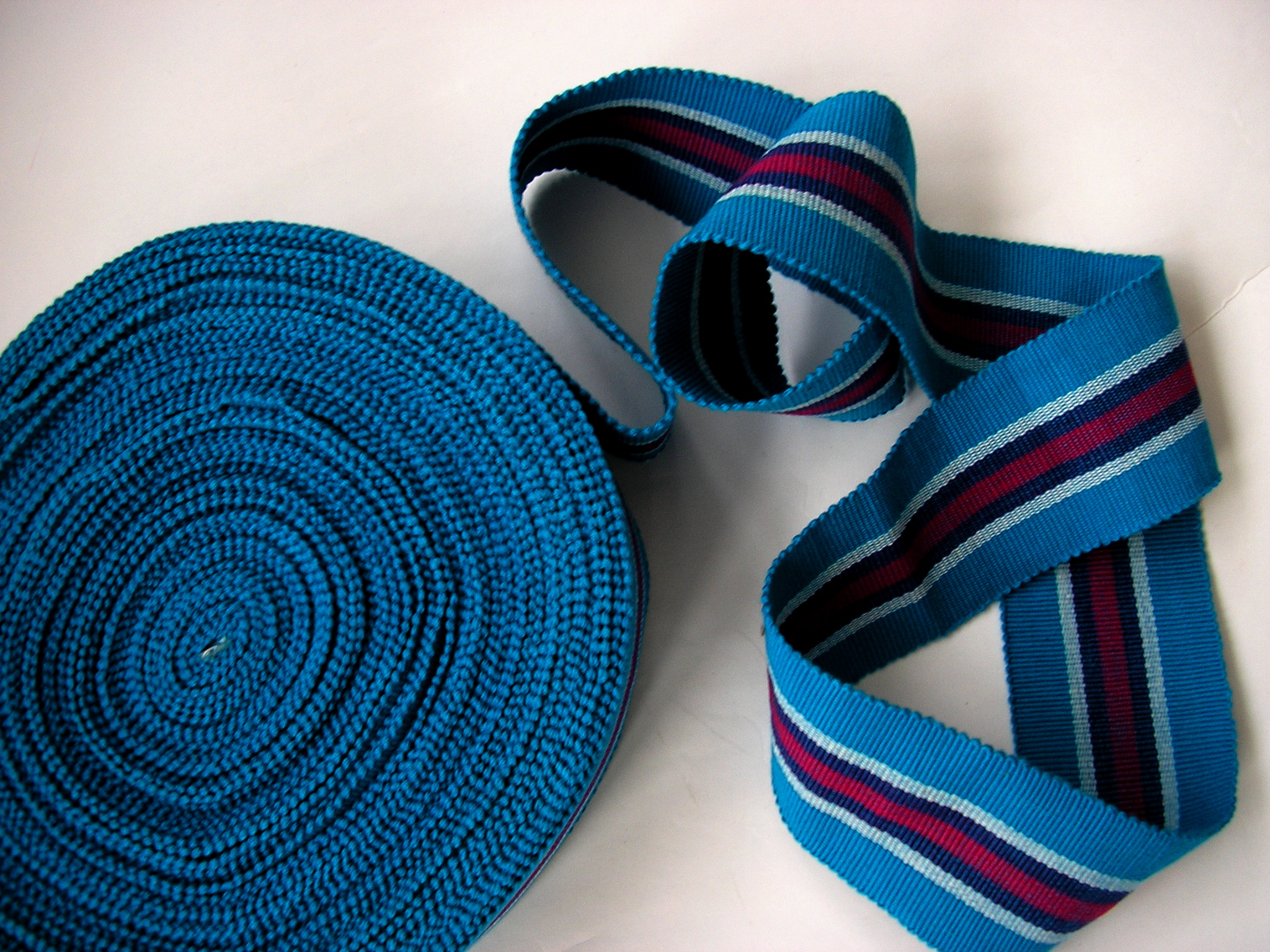 Turquoise, red and white stripe webbing
