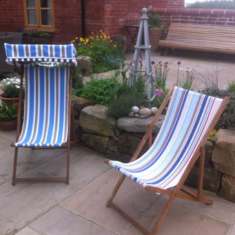Recovered Deck Chairs one with canopy and bobble fringe