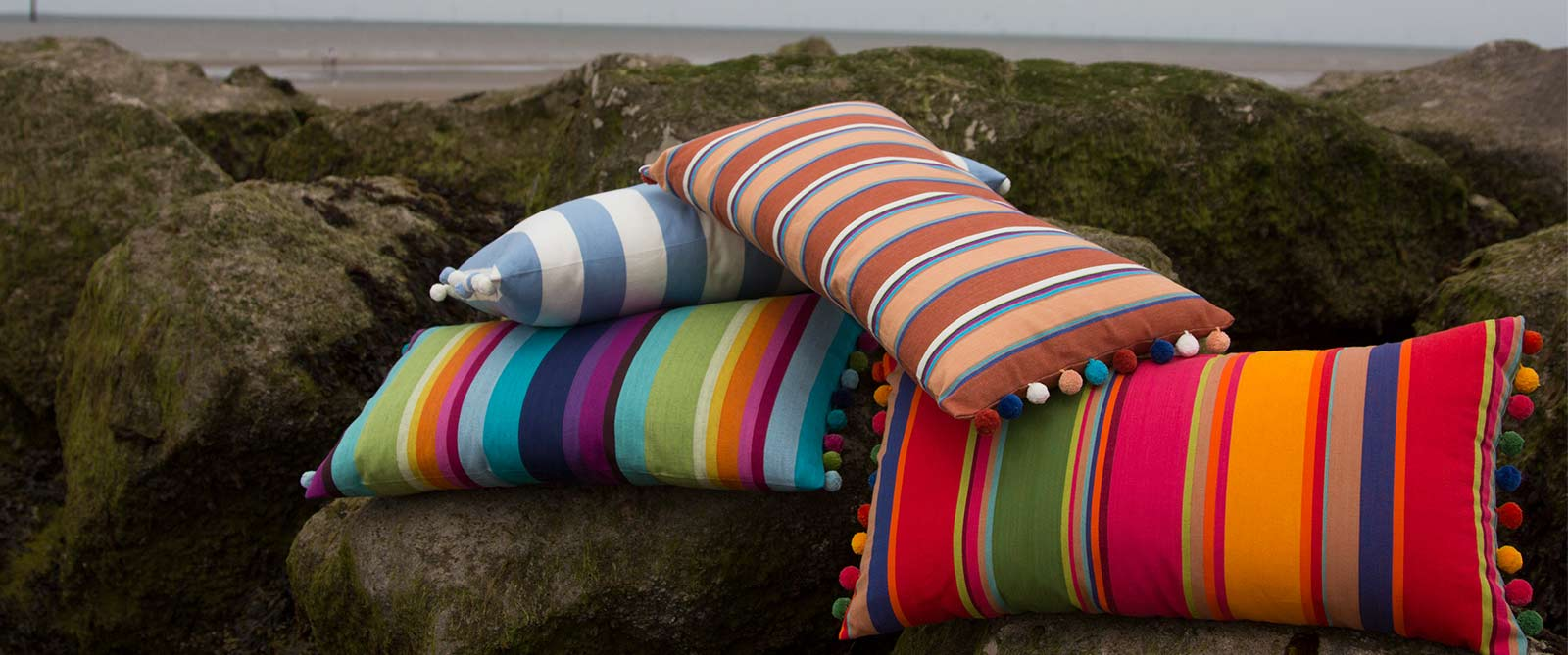 Orange Striped Oblong Cushions with Bobble Fringe  Karting Orange Stripes