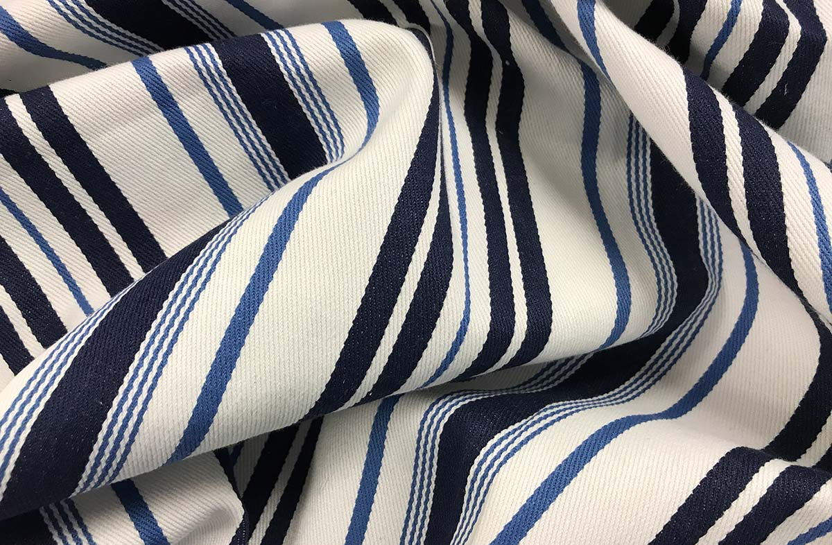 White, airforce blue and navy ticking striped fabric